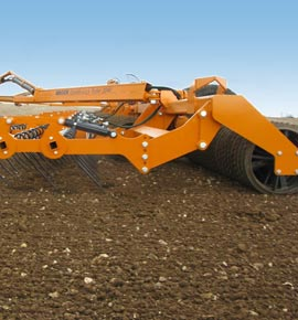Photo of the Brock 2040 Double Lock Roller working a stony field